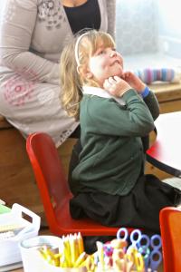child in nursery looking at bishop